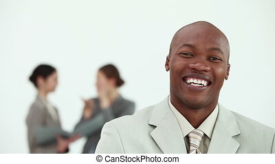 Businessman laughing in the foreground