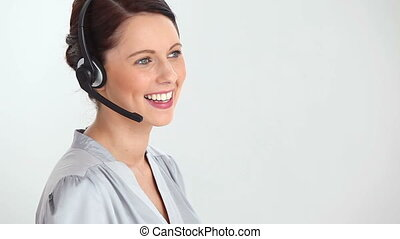 Businesswoman using a headset device against a white...