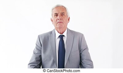 Manager crossing his arms against a white background