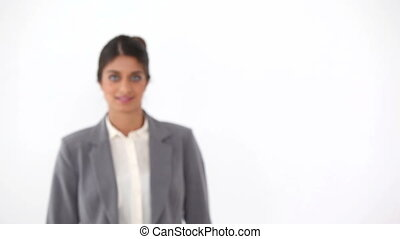 Black haired businesswoman against white background
