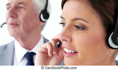 Cheerful business people using headsets