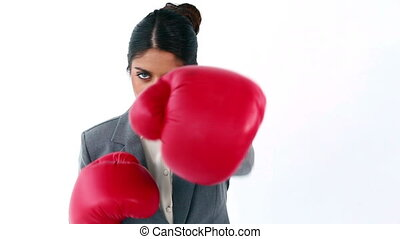 Serious secretary boxing against a white background