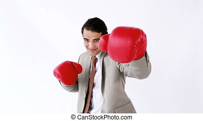 Happy executive boxing against a white background