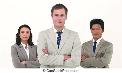 Business team crossing their arms against white background