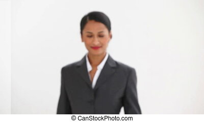 Woman in a suit walking against white background