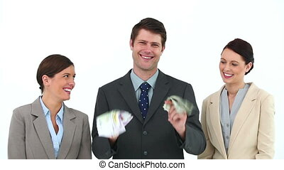 Businessman shaking bank notes with two colleagues against...