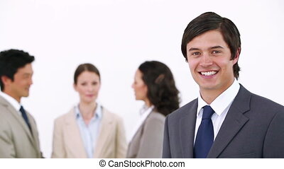 Businessman laughing - Businessman Laughing with co-workers...