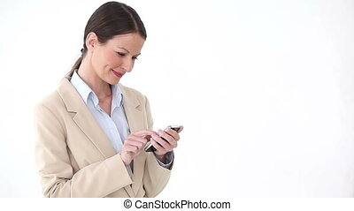 Businesswoman using a mobile phone against a white...