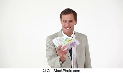 Businessman counting bank notes against white background