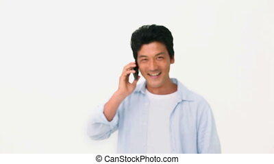 Man posing while on the phone
