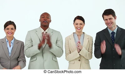 Business people clapping against white background