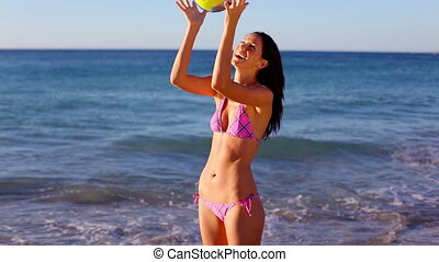 Smiling woman playing volleyball