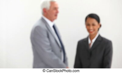 Businesswoman walking into focus before poising with her...