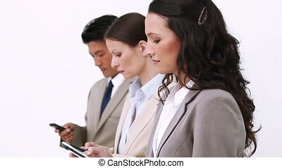 Business team sending text messages against white background