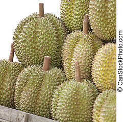 Durians at market with isolated white background.