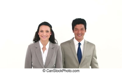 Two business people posing against a white background