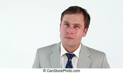 Thoughtful man standing upright against a white background