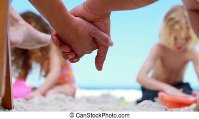 Children building sand castles on the beach