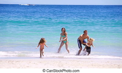Happy family splashing each other
