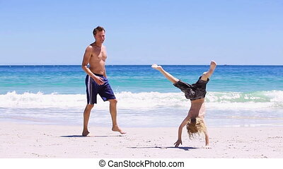 Father doing handstands with her son