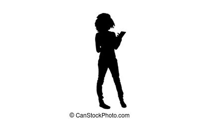 Silhouette woman using a tablet computer - A silhouette...
