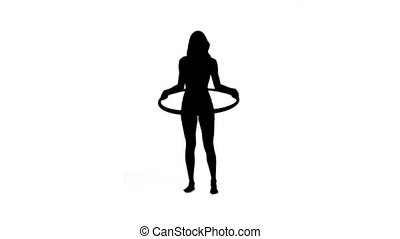 Silhouette of a woman with a hula hoop - A silhouette of a...