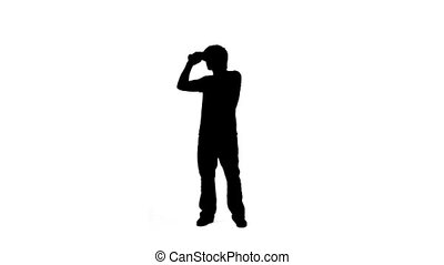 Silhouette man using binoculars - A silhouette man is using...