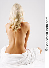 Blonde girl with bare back in the spa