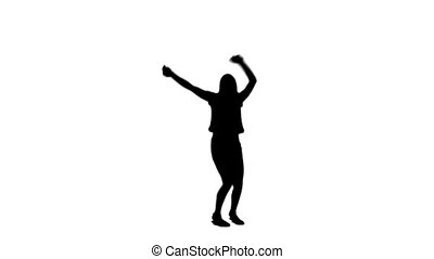 Silhouette woman jumping with her arms raised - A silhouette...
