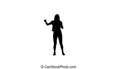 Silhouette of a woman dancing with her arms raised - A...