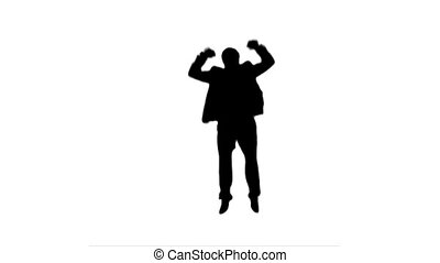 A silhouette excited man jumping