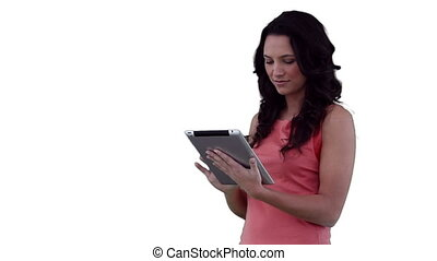 Woman pressing the screen of her tablet computer