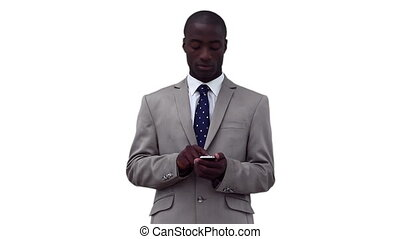 Businessman using a phone before looking around him against...