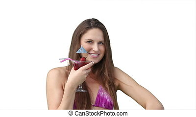 Woman in bikini enjoying a cocktail