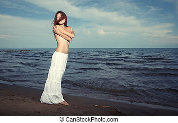 Windy beach - Sensual lady stands at the beach