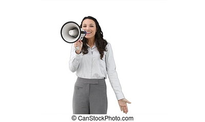 Woman shouting through a megaphone against a white...