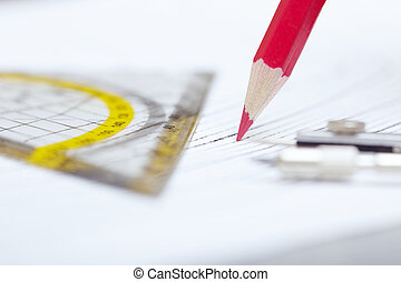 Engineering - Drawing tools on a paper Extremely close-up...