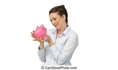 business woman with a piggy-bank in her hands against a...