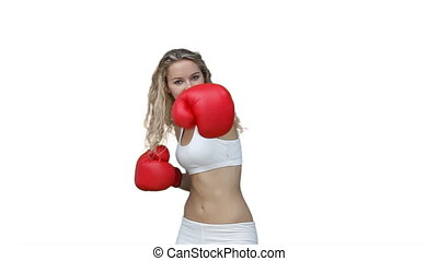 Woman boxing in her training clothes against a white...