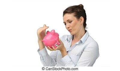 Business woman rubbing her piggy-bank