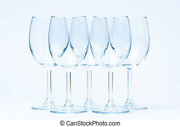 Empty wine glasses stand symmetrically on white - Empty wine...