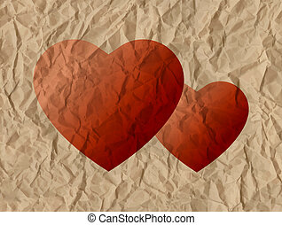 Two hearts on a crumpled paper