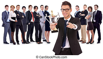 winning business team with leader holding a big trophy cup...