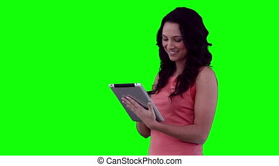 Woman using a tablet before looking at the camera