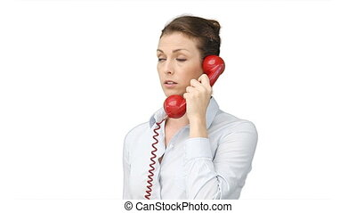 A business woman talking on a telephone