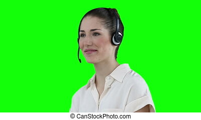 Businesswoman talking through a headset