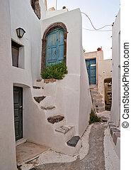Village street with staircases and entrance doors in...