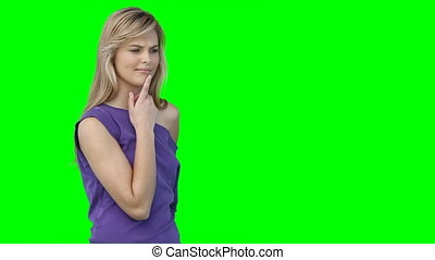 A woman using a virtual keyboard against a green background