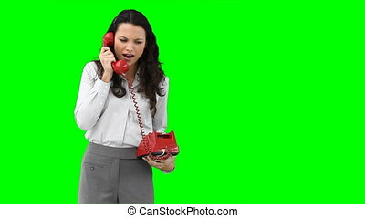 A woman on the phone talking aggressively