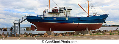 Fishing trawler - museum in sea harbor, Ventspils, Latvia
